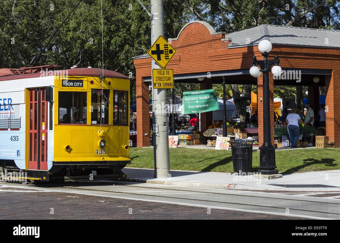TECO Line streetcar stops at Saturday Market in historic Ybor City District. - Stock Image