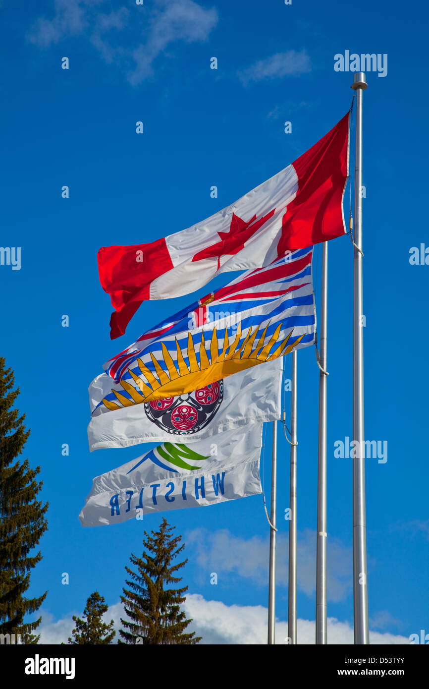 Canadian and British Columbia flags with a First Nations and a Whistler village flag - Stock Image