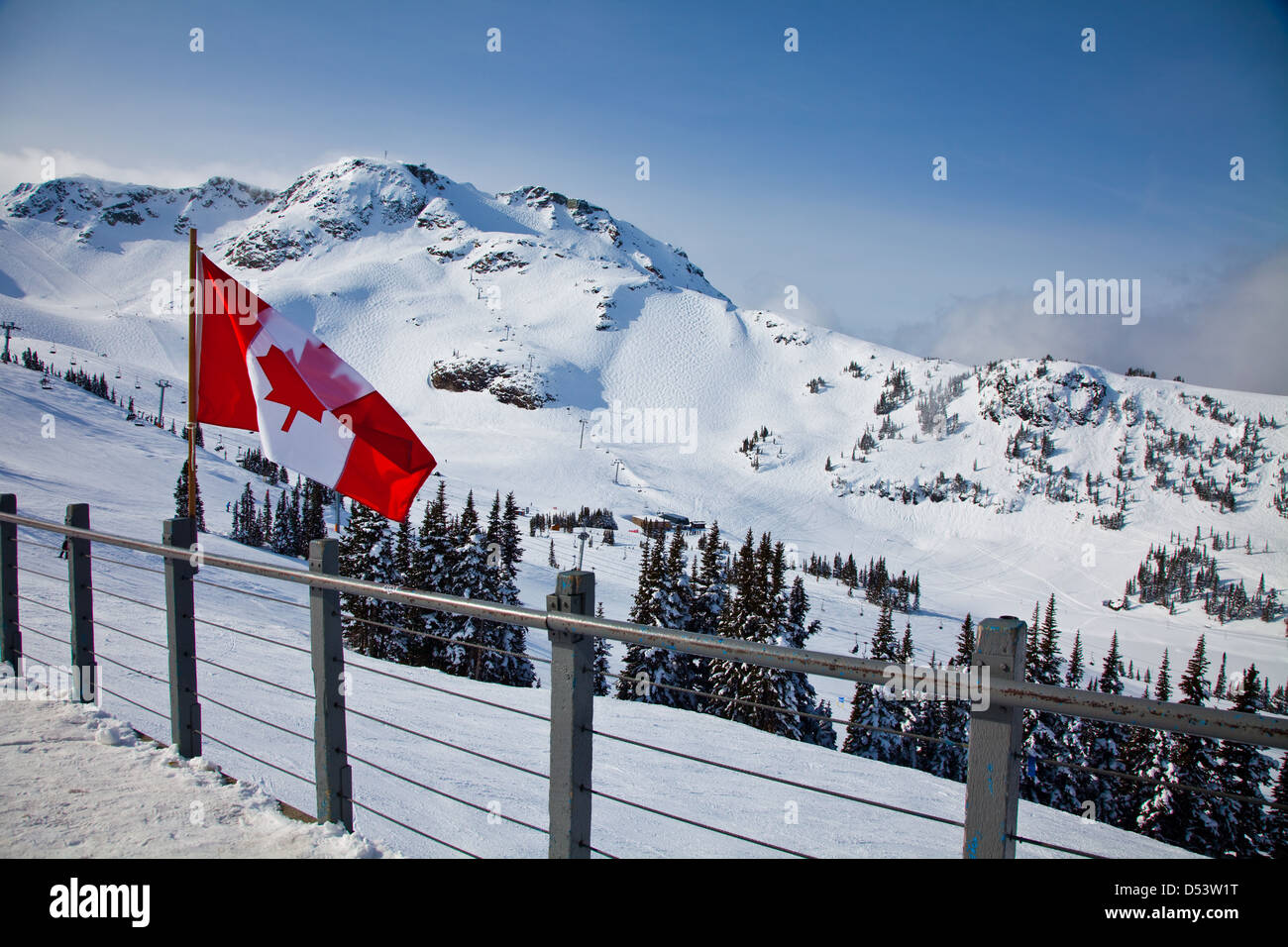 Canadian flag against a backdrop of Whistler Mountain, British Columbia, Canada - Stock Image