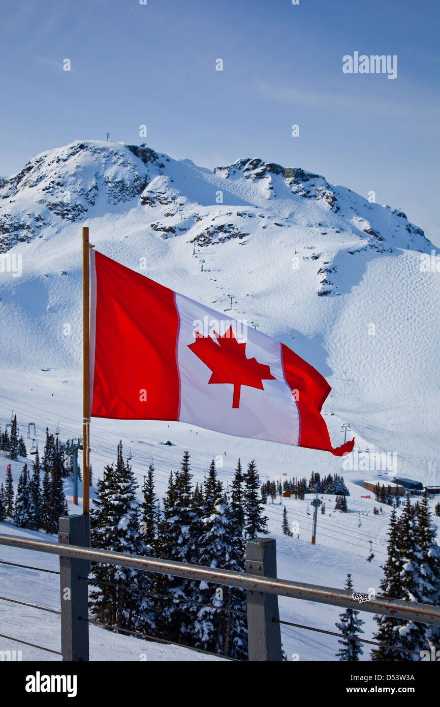 Canadian flag with Whistler Mountain in the background - Stock Image