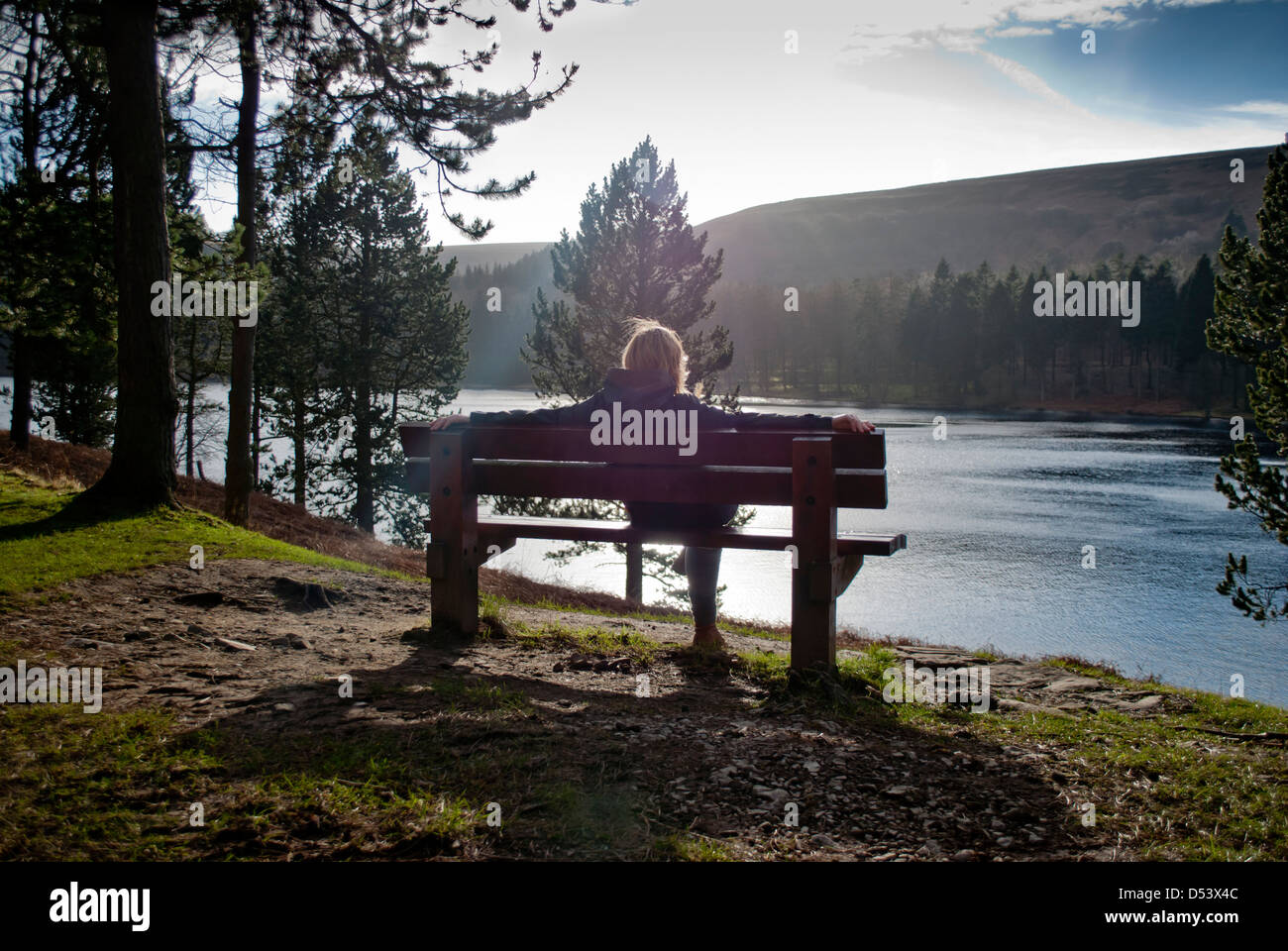 Countrside Walker Resting on a Bench - Stock Image