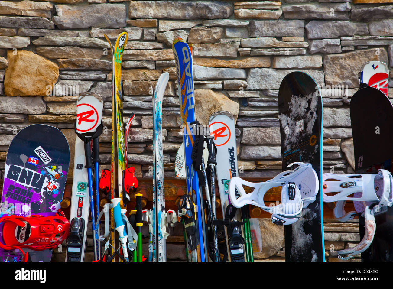 Skis and Snowboards leaning against the Roundhouse Lodge on Whistler mountain Stock Photo