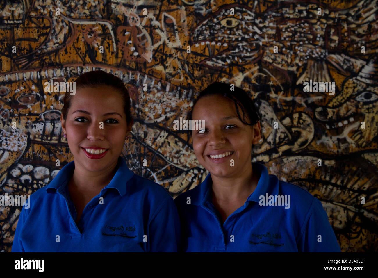 Smiling receptionists at Morgan's Rock Hacienda & Ecolodge, near San Juan del Sur, Nicaragua. - Stock Image