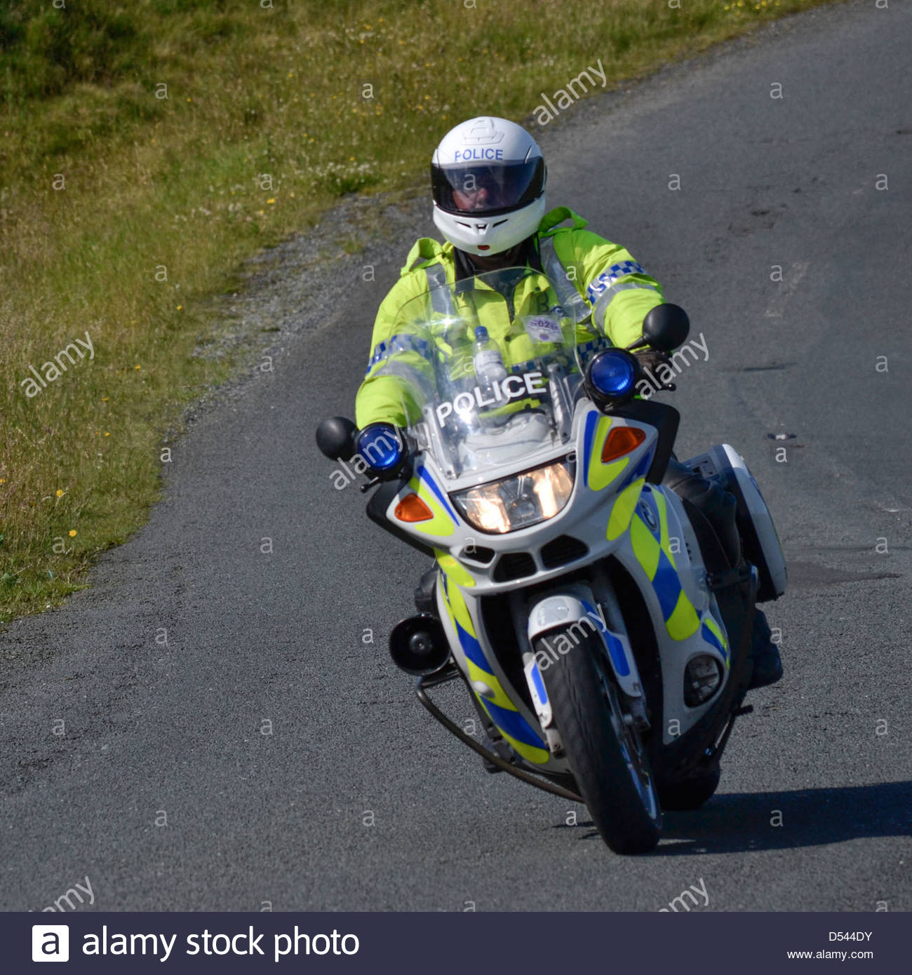 Police motor bike rider policing the Bolton Ironman, July 2012 - Stock Image