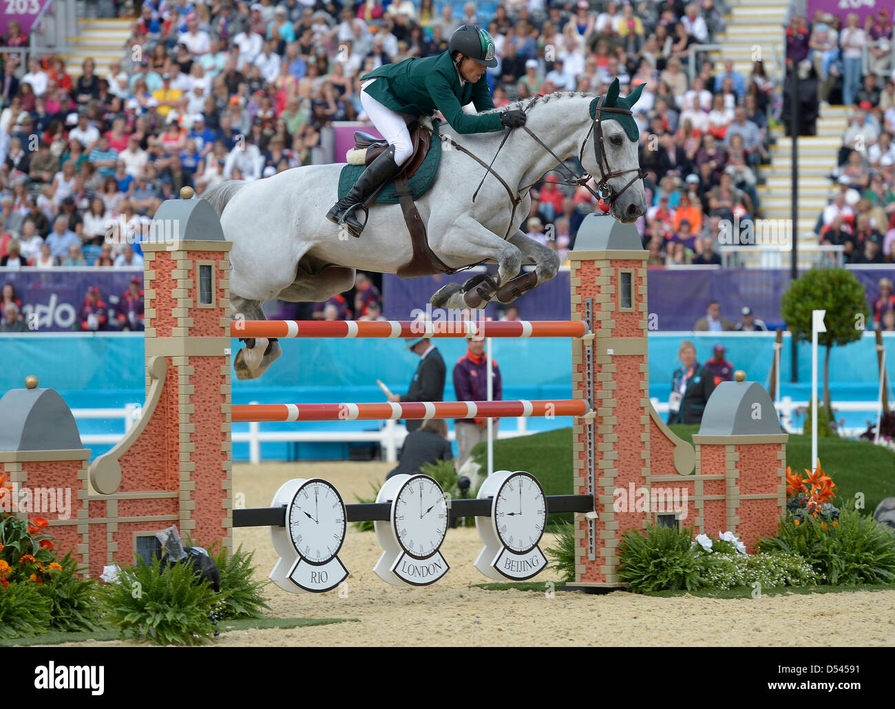 Abdullah Waleed Sharbatly riding Sultan (KSA, Saudi Arabia). Team Showjumping - Stock Image