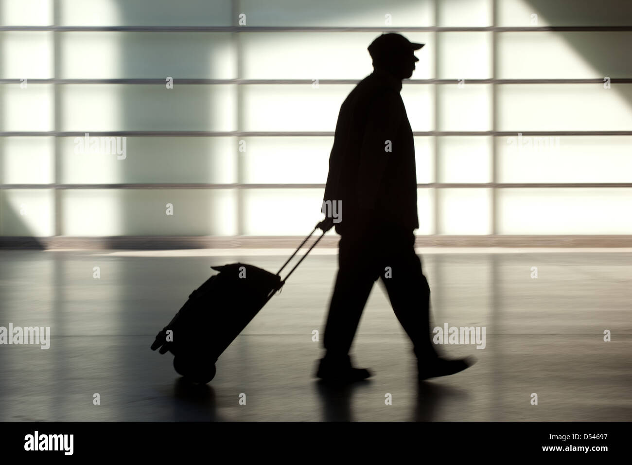 Berlin, Germany, the silhouette of a pensioner with shopping trolley - Stock Image