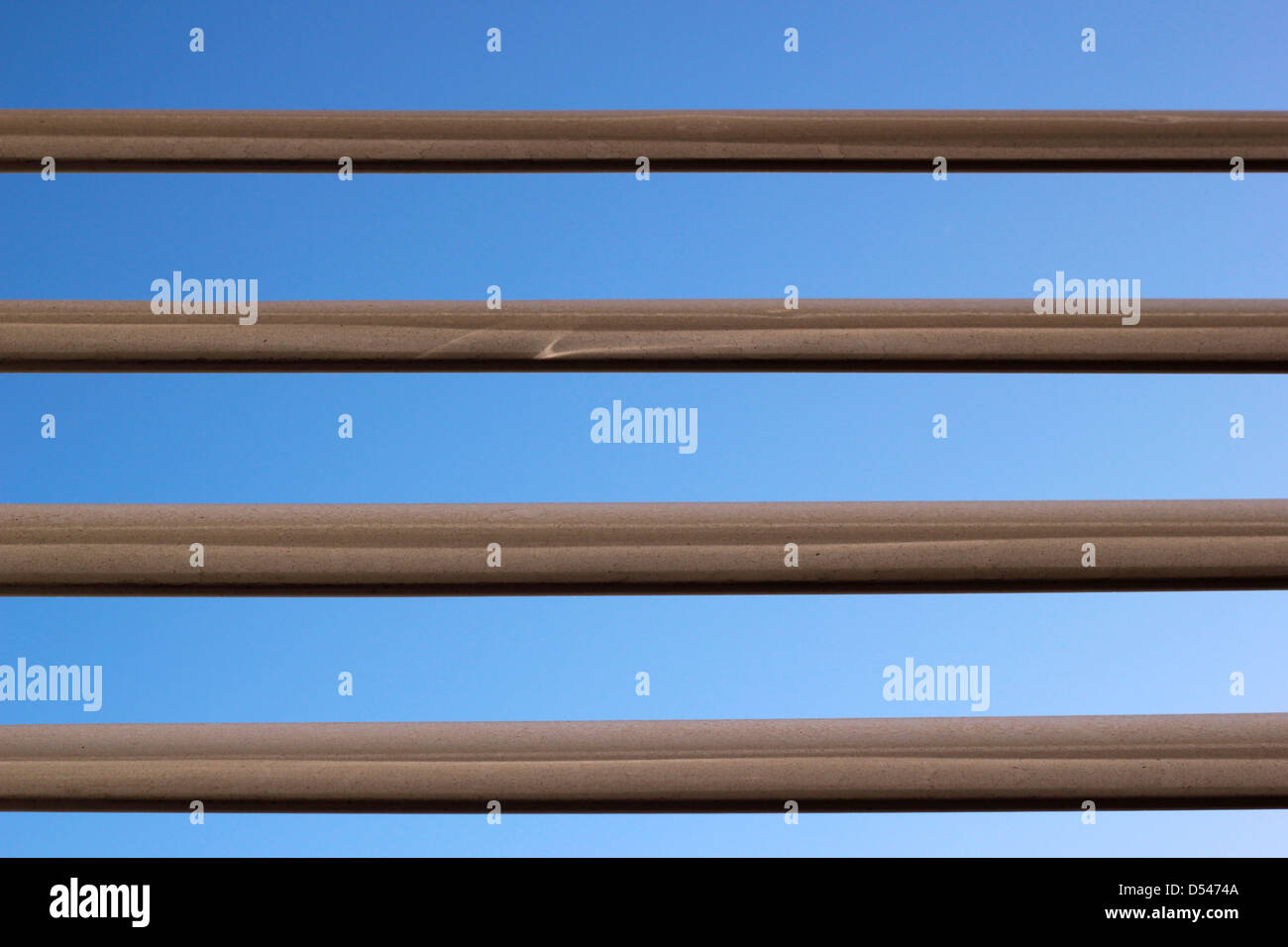 Window blinds with blue cloudless sky - Stock Image