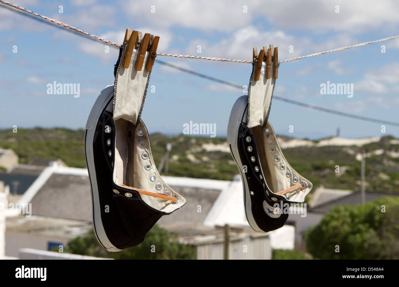 Converse All Stars hanging out to try. - Stock Image