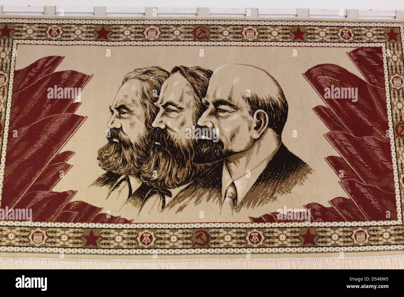 Artwork depicting communist thinkers (L-R) Karl Marx, Friedrich Engels, and Vladimir Lenin. At the Stasi Museum, - Stock Image