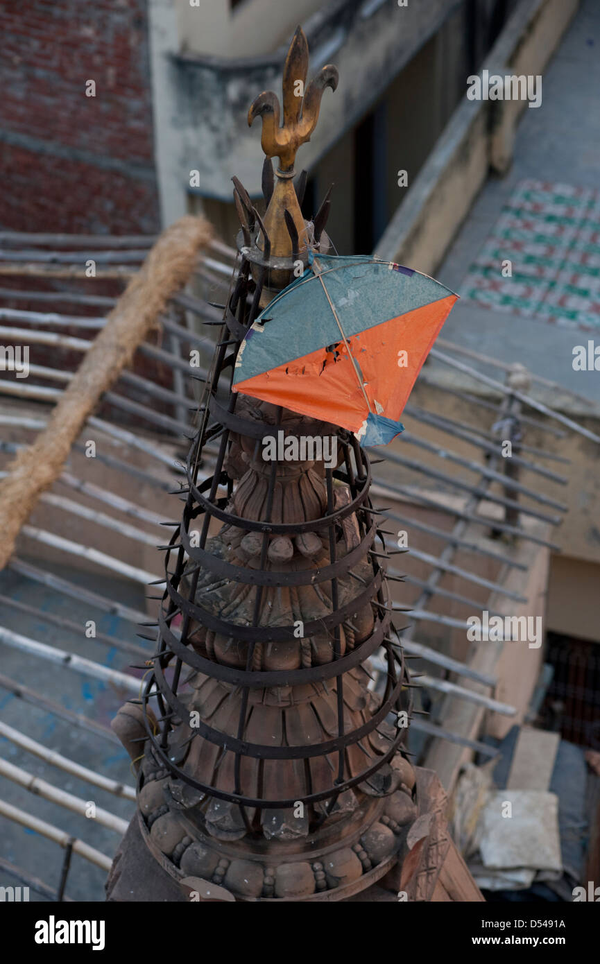A paper kite, caught on the spire of a temple at Varanasi, India. - Stock Image