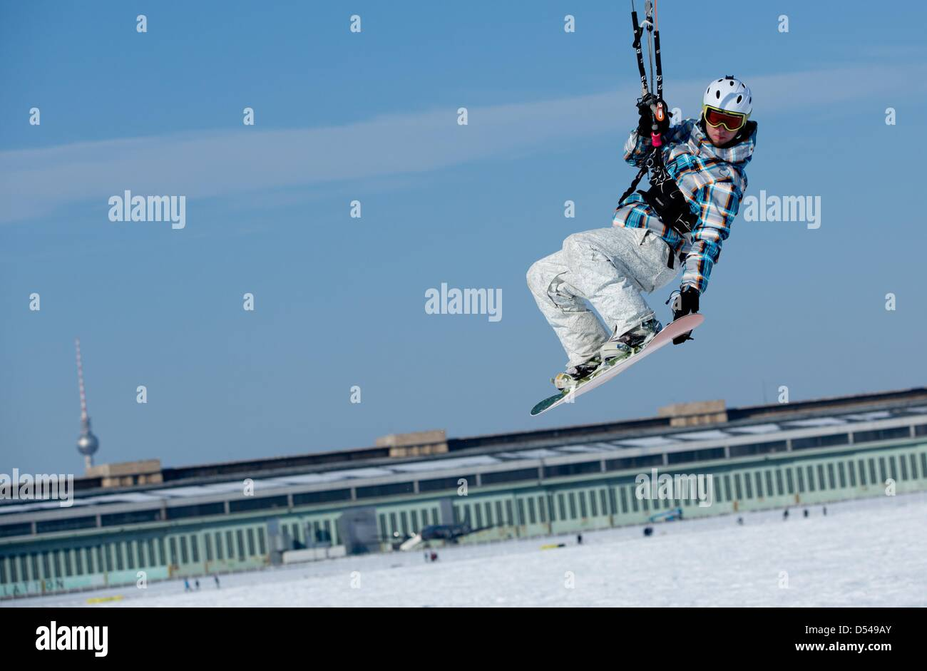 A snowkiter takes off at Tempelhofer Feld in Berlin, Germany, 24 March 2013. Sun and strong winds offer best conditions - Stock Image