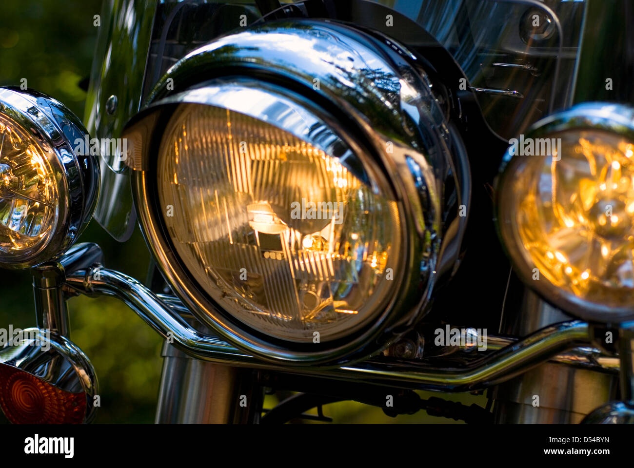 Close-up of motorcycle lights, shallow dof, focus on left-turn signal - Stock Image