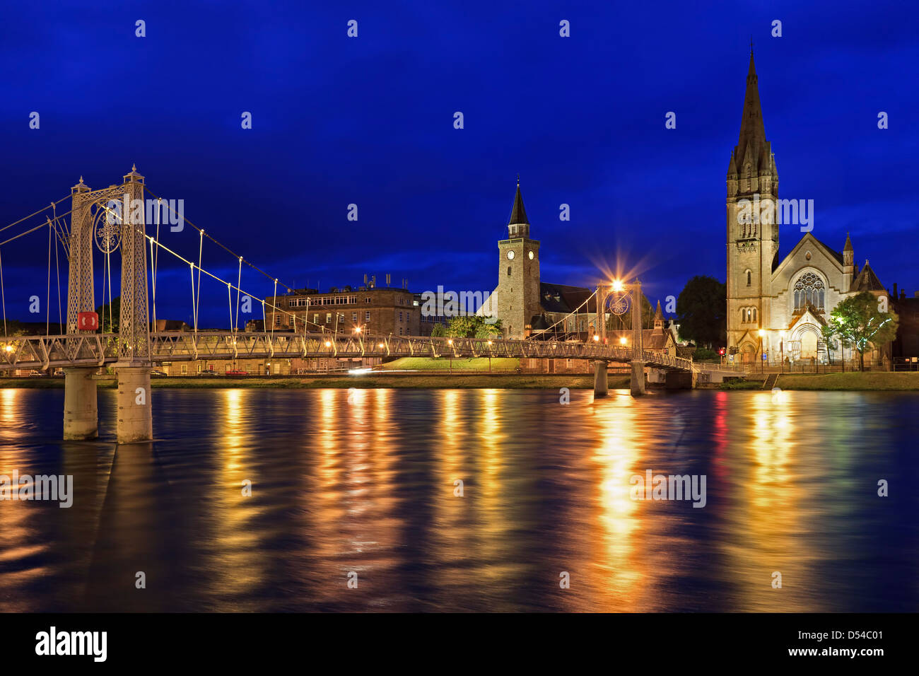 Footbridge over River Ness and churches, Inverness, Scotland, United Kingdom - Stock Image