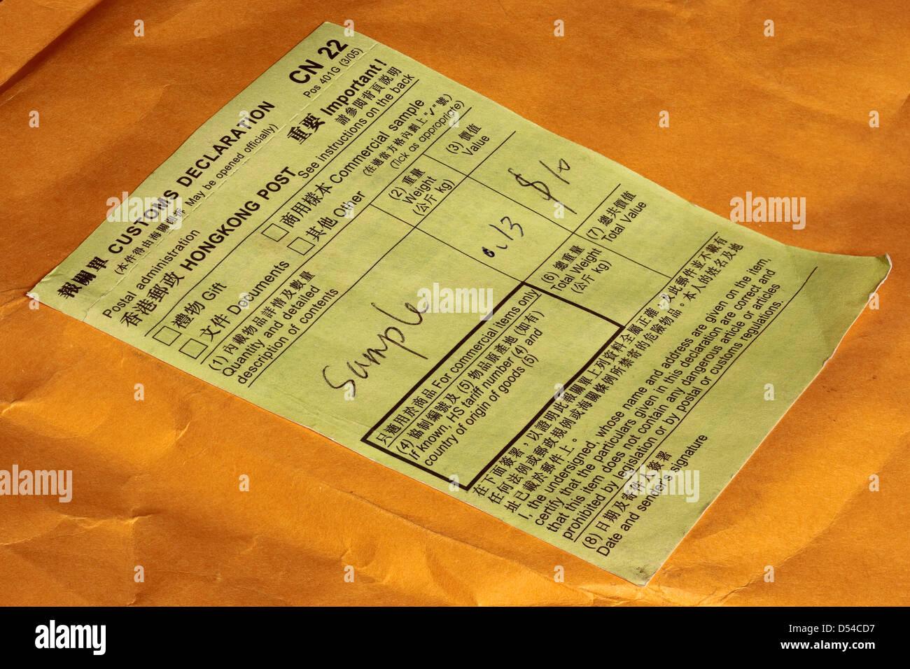 Green Customs Declaration CN 22 sticker on International Post Hong Kong to UK - Stock Image