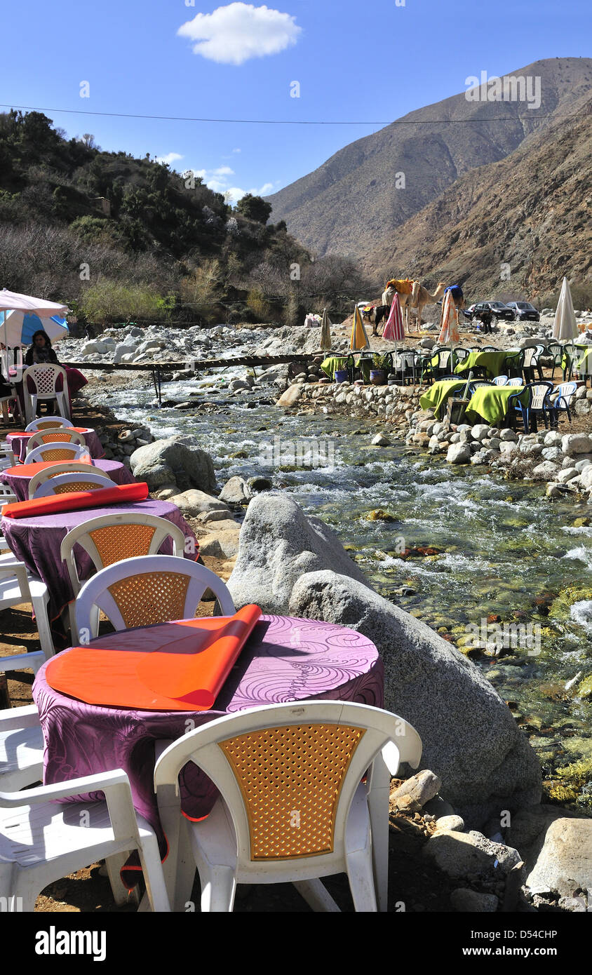 River sides eateries line the river side of the popular Setti Fatma near Cascades, Ourika Valley ,Morocco - Stock Image