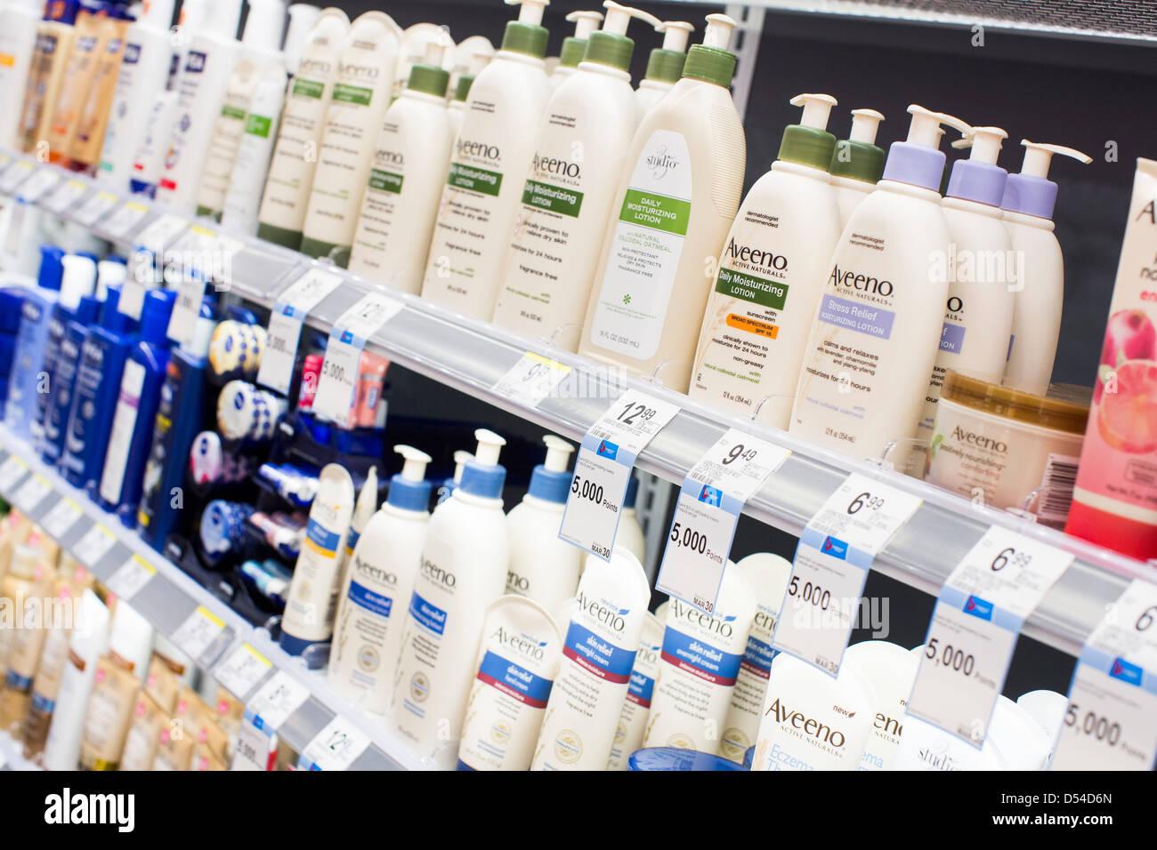 Aveeno lotion on display at a Walgreens Flagship store in downtown Washington, DC. - Stock Image