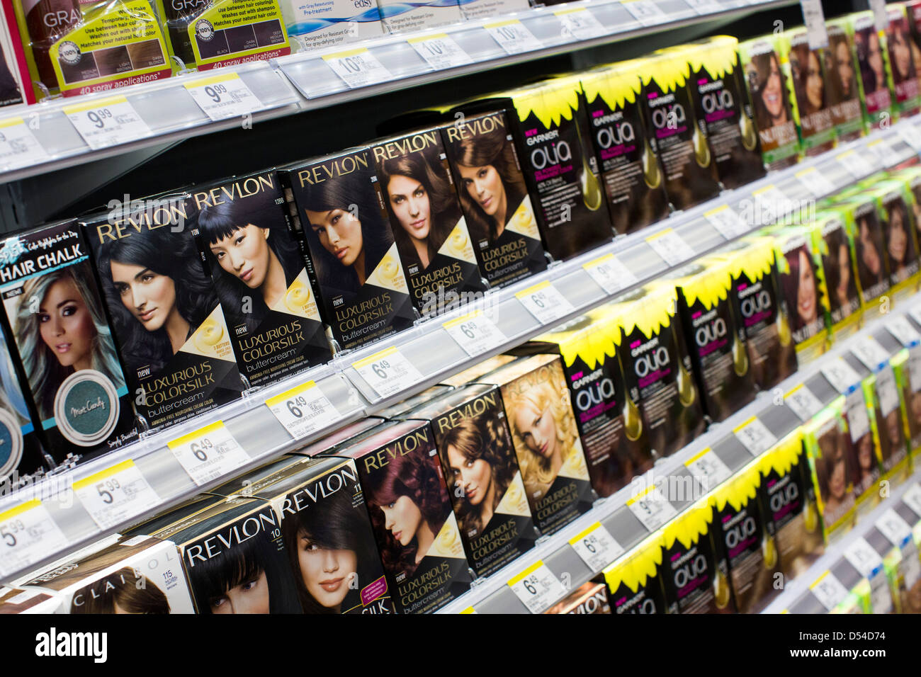 Revlon and Garnier hair dye products on display at a Walgreens Flagship store in downtown Washington, DC. - Stock Image