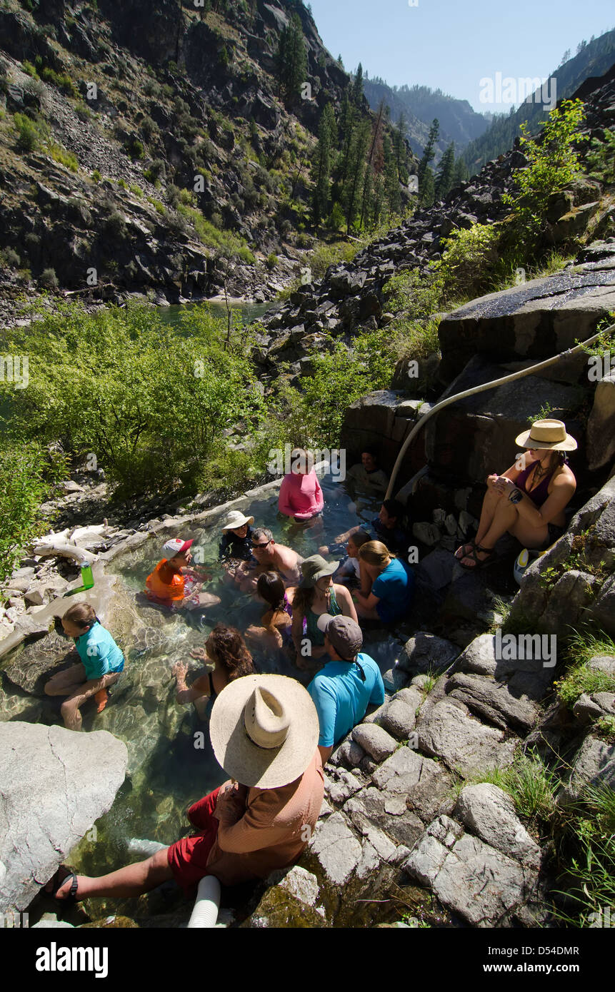 Group enjoying a soak in Barth Hot Springs on a raft trip down Idaho's Salmon River. - Stock Image
