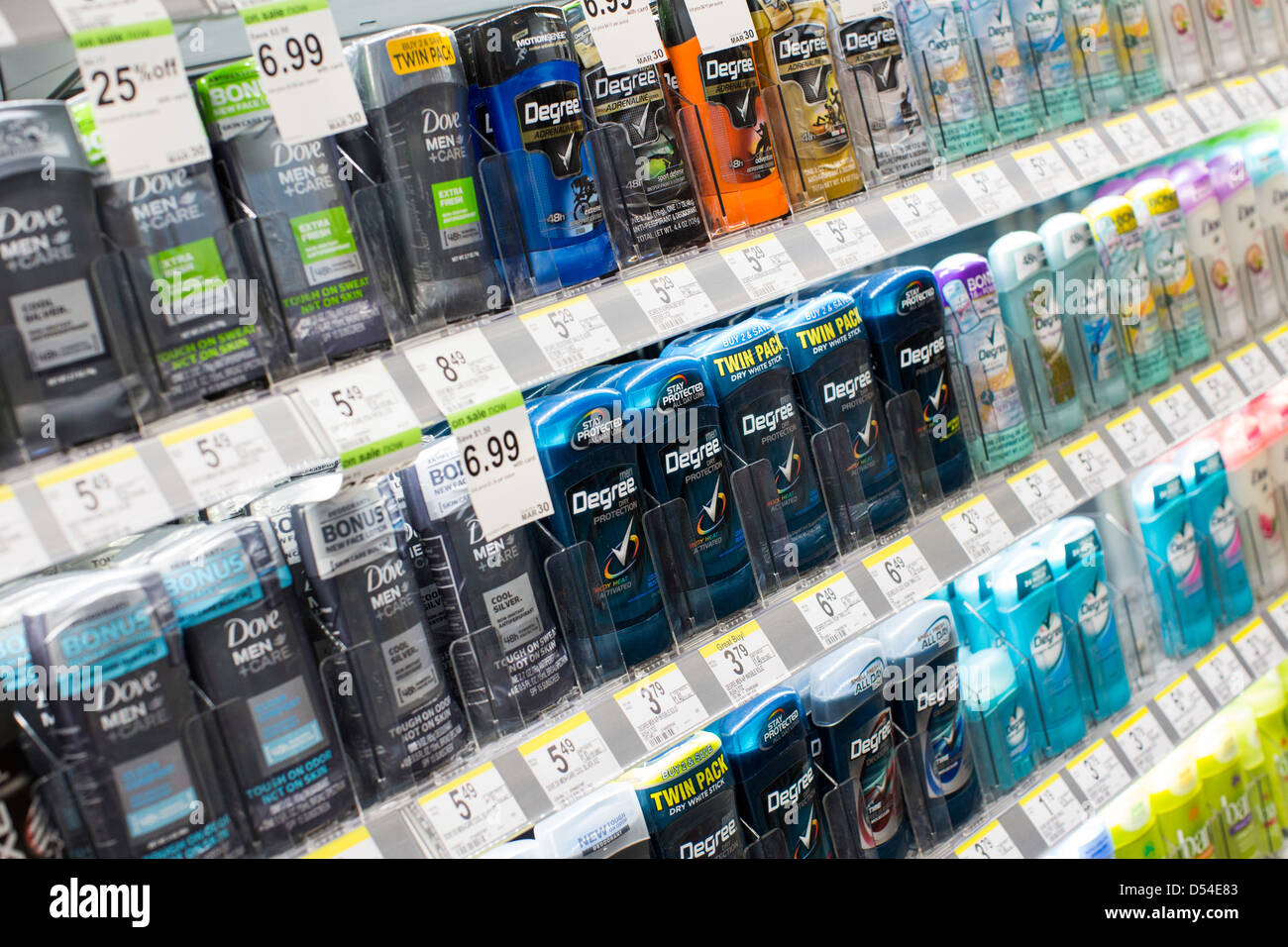 Dove and Degree deodorant products on display at a Walgreens Flagship store. - Stock Image