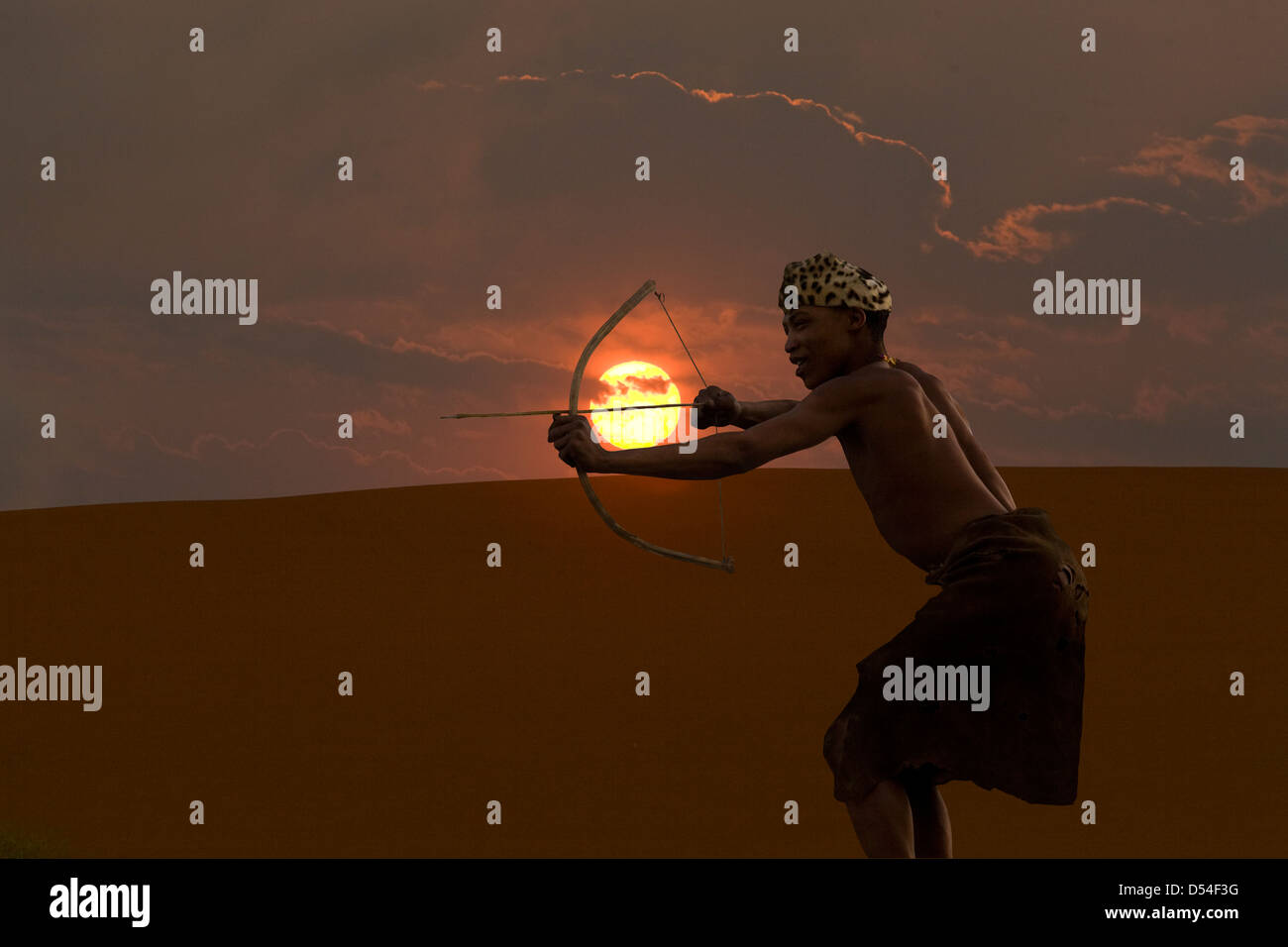 Bushman archer in Namibia silhouetted against sunset - Stock Image