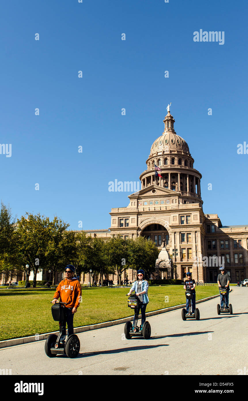 People sightseeing on a Segway by the Capitol building in Austin Texas United States - Stock Image