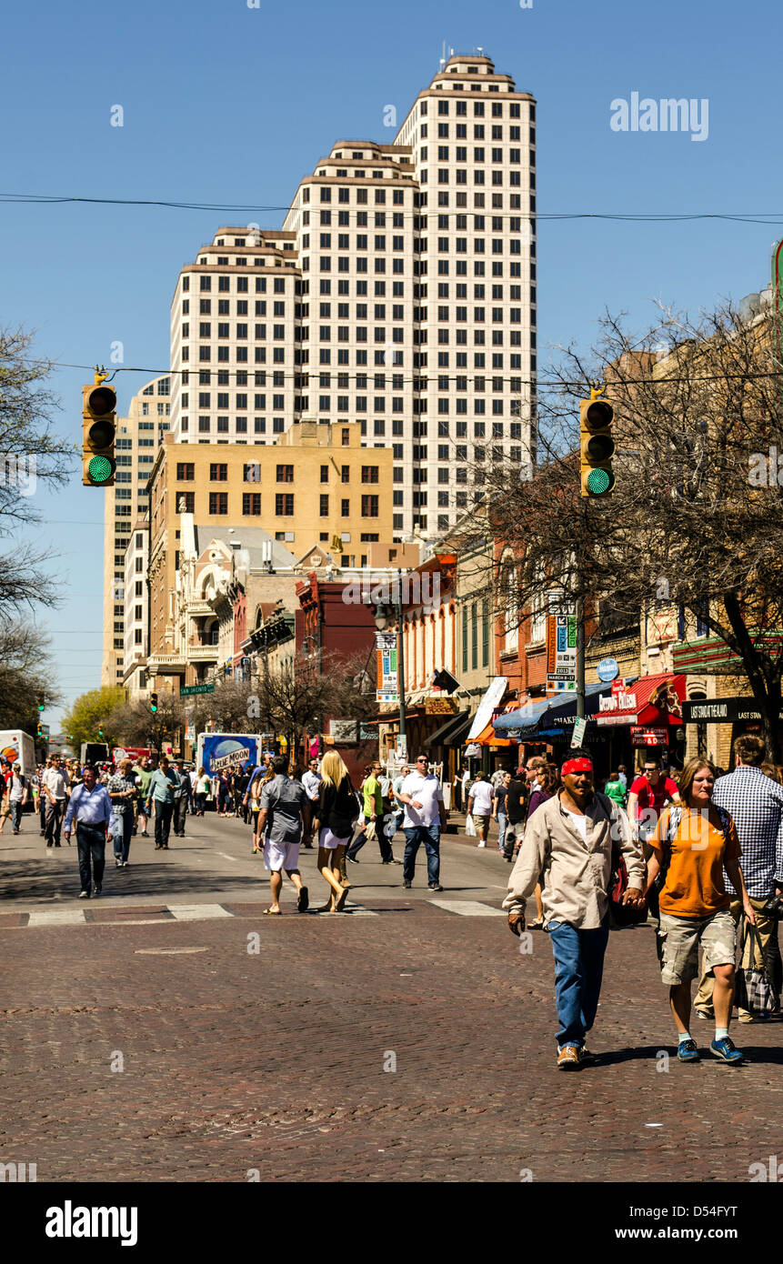 People walking around the 6th Street during SXSW Music festival Austin Texas US - Stock Image