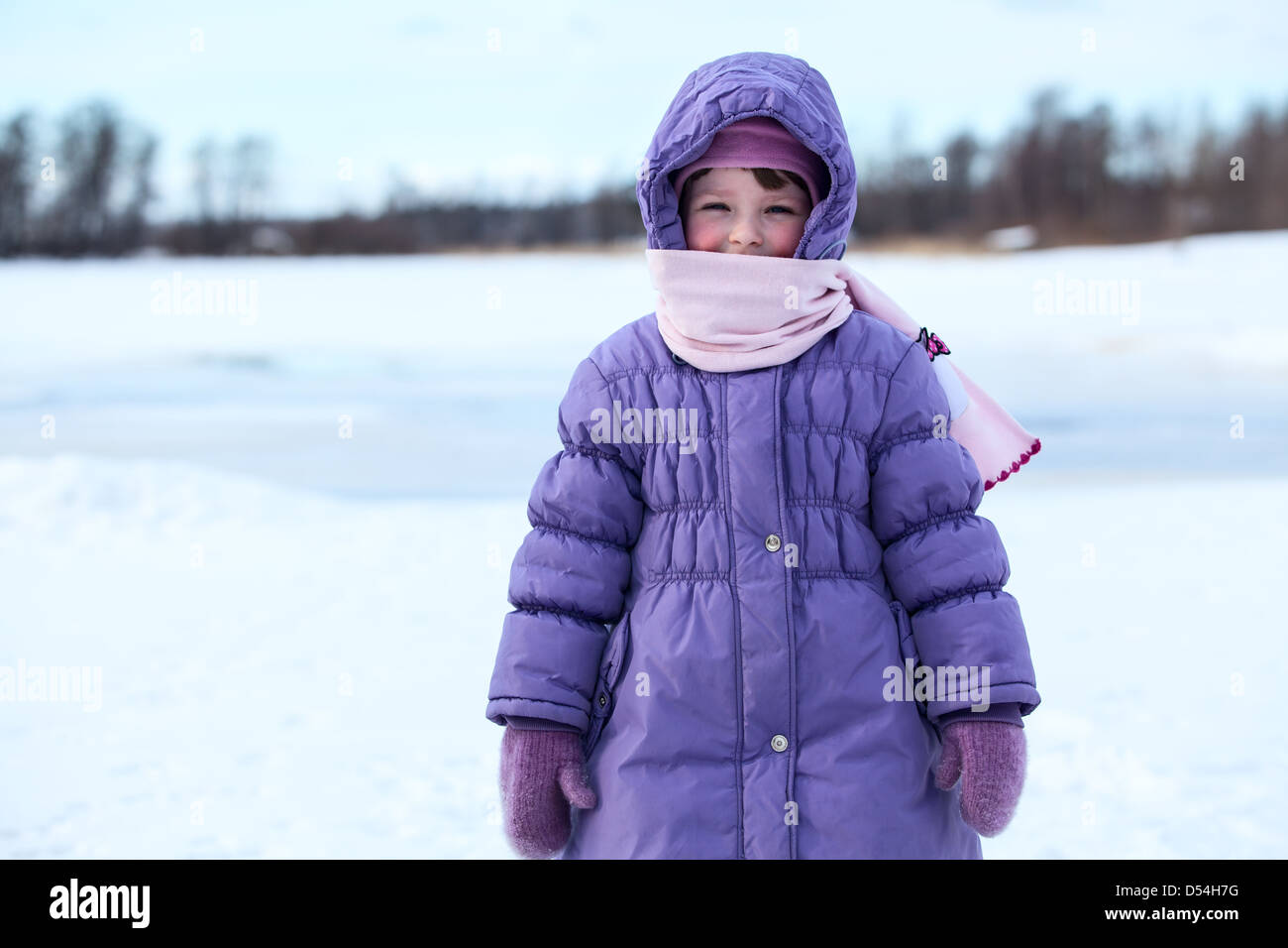Wrapped In Warm Clothes Small Child Standing Outdoor In
