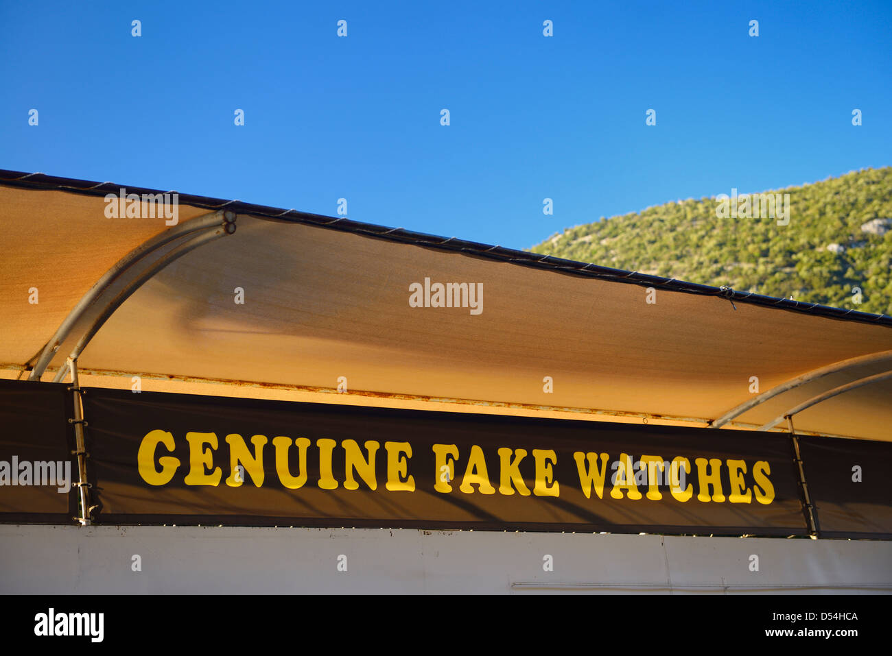Ironic sign for genuine fake watches at the entrance to the ancient city of Ephesus Turkey - Stock Image