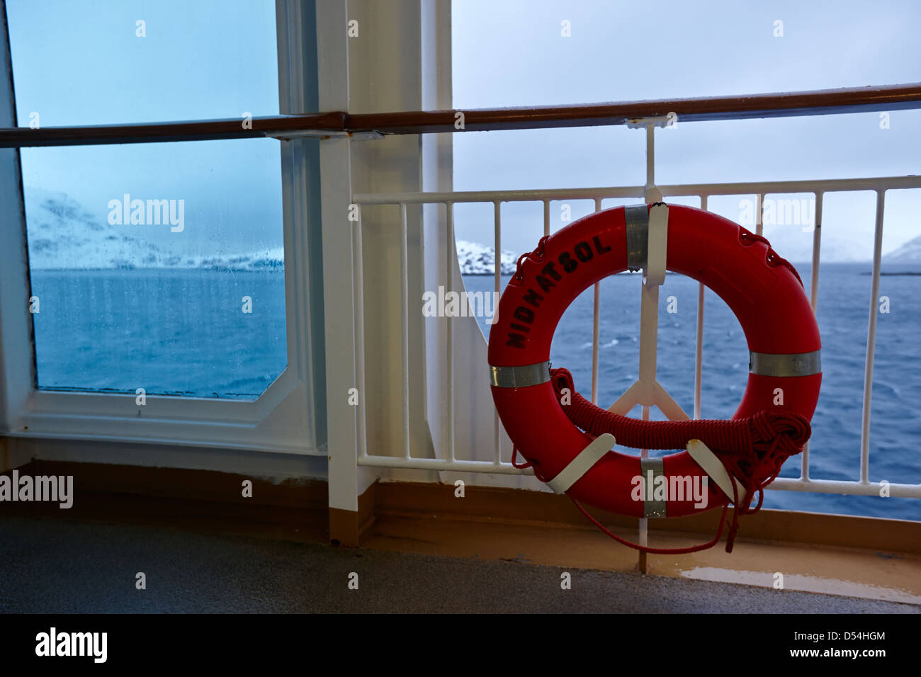 mv midnatsol lifebelt on board hurtigruten passenger ship sailing through fjords during winter norway europe - Stock Image