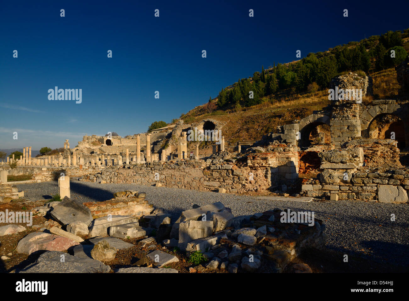 Basilica stoa royal porch at the state Agora with the Odeon at left and gymnasium at right in ancient Ephesus Turkey - Stock Image