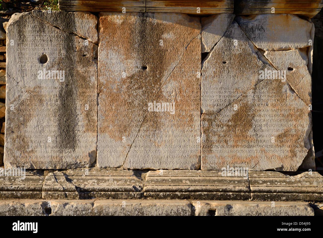 Greek inscription on stone blocks on Curetes street of ancient Ephesus Turkey - Stock Image