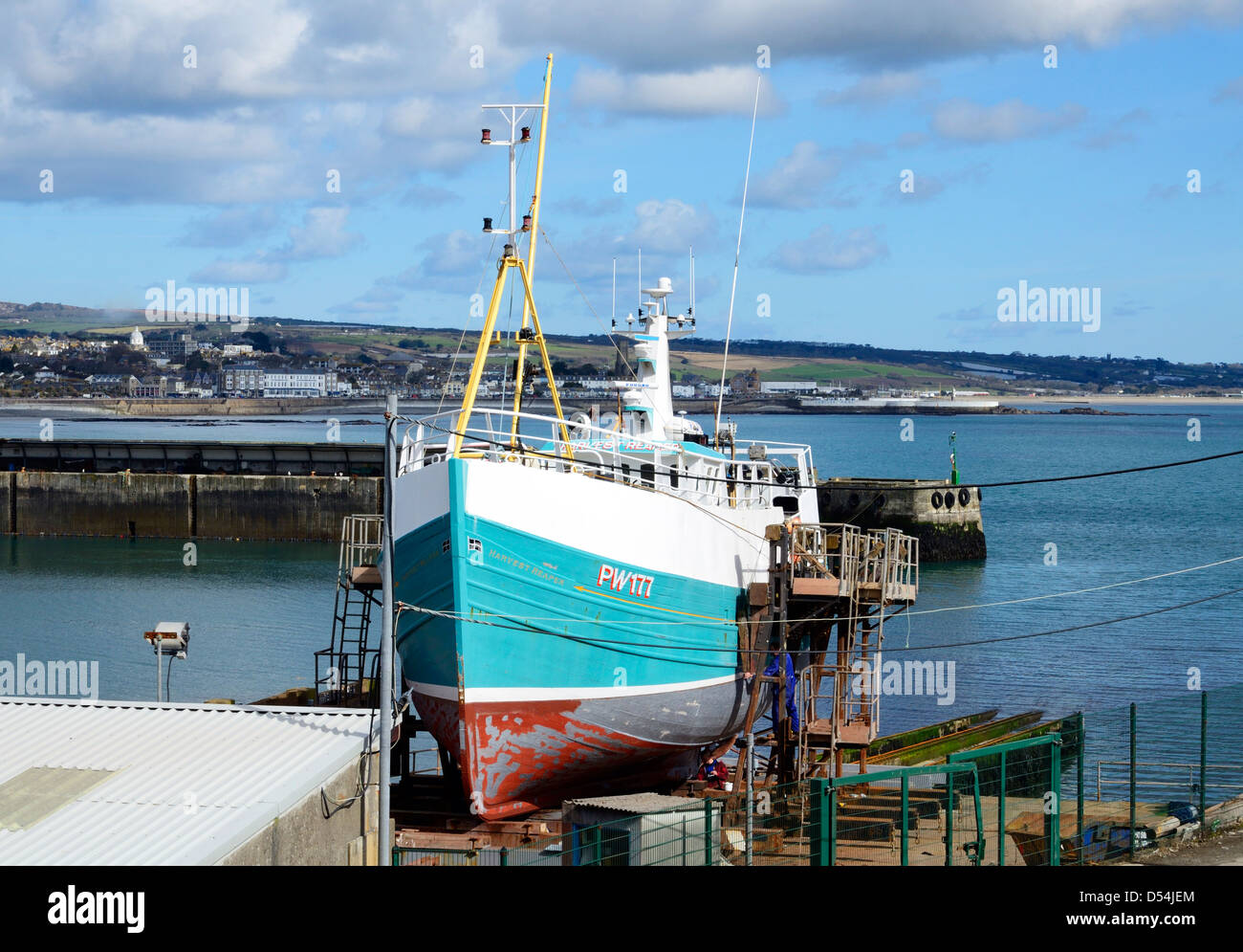 A fishing trawler in dry dock for repairs at Newlyn, Cornwall, UK - Stock Image
