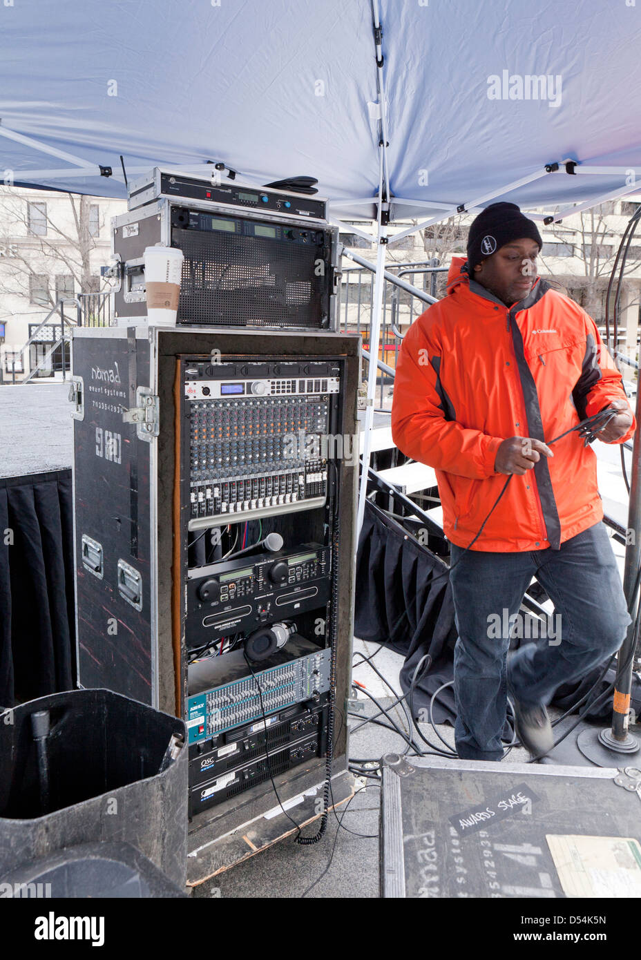 Audio technician at an outdoor event - USA - Stock Image