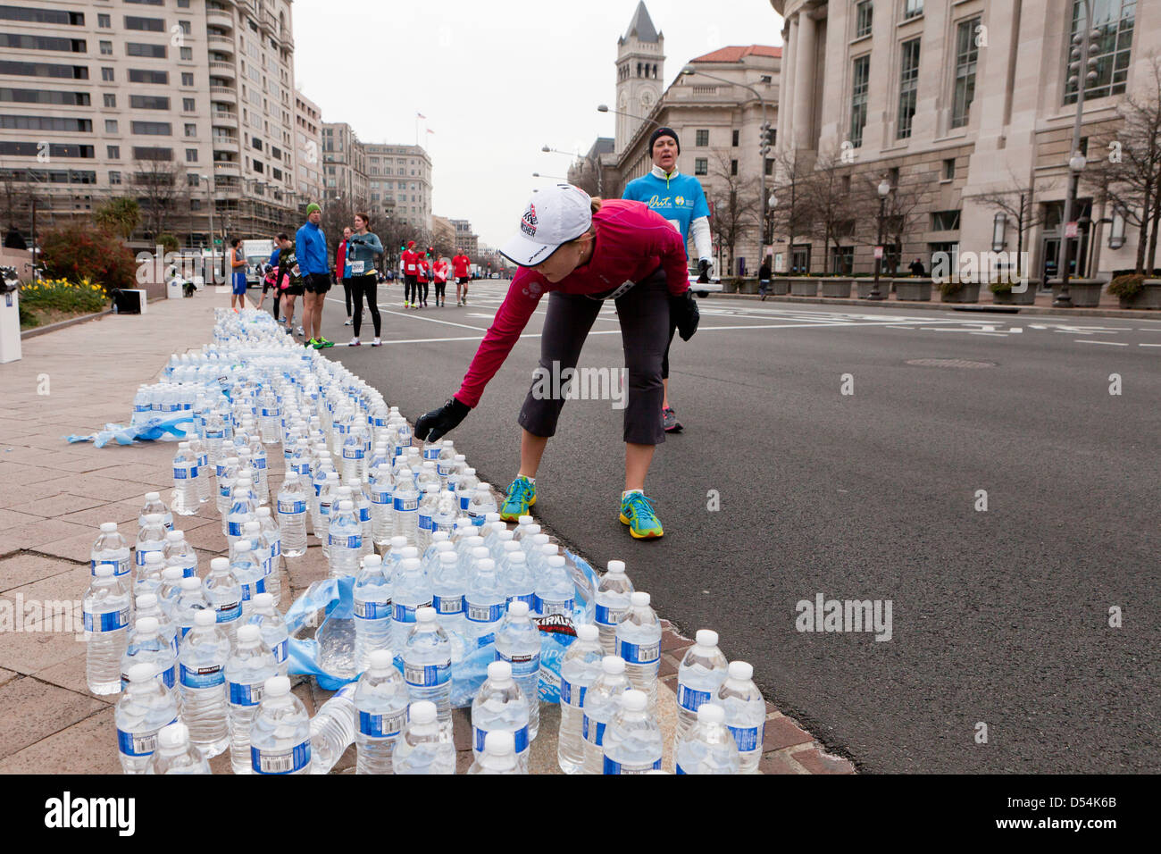 Runners picking up bottled water after race - Stock Image
