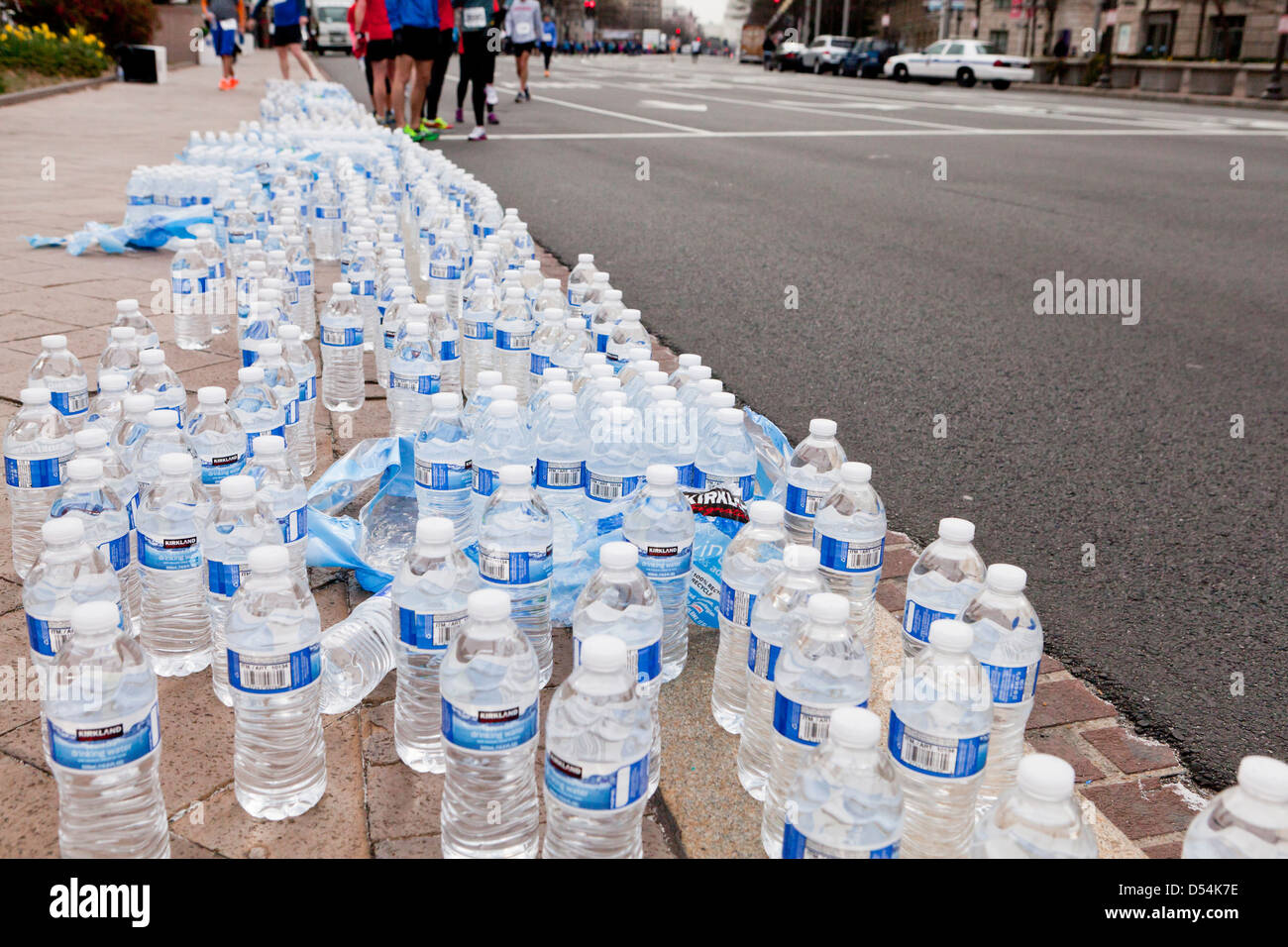 Bottled water lined up for race runners - Stock Image