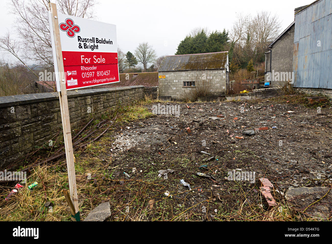 For sale sign on plot of building land in town of Rhaeadr, Wales, UK - Stock Image