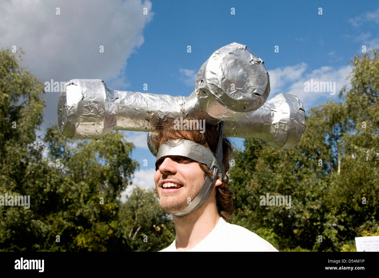 Man with model water tap on his head as part of a display to encourage the drinking of tap water - Stock Image