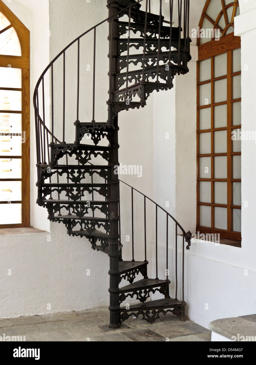 decorative 19th century cast iron spiral stair between levels at textile mill converted to Center for the Arts San Stock Photo