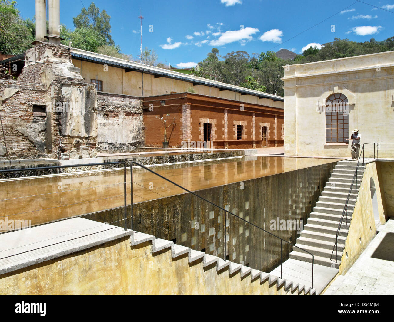 reflecting pool & spillway at staircase leading to entrance of Center for the Arts via the back of converted textile Stock Photo