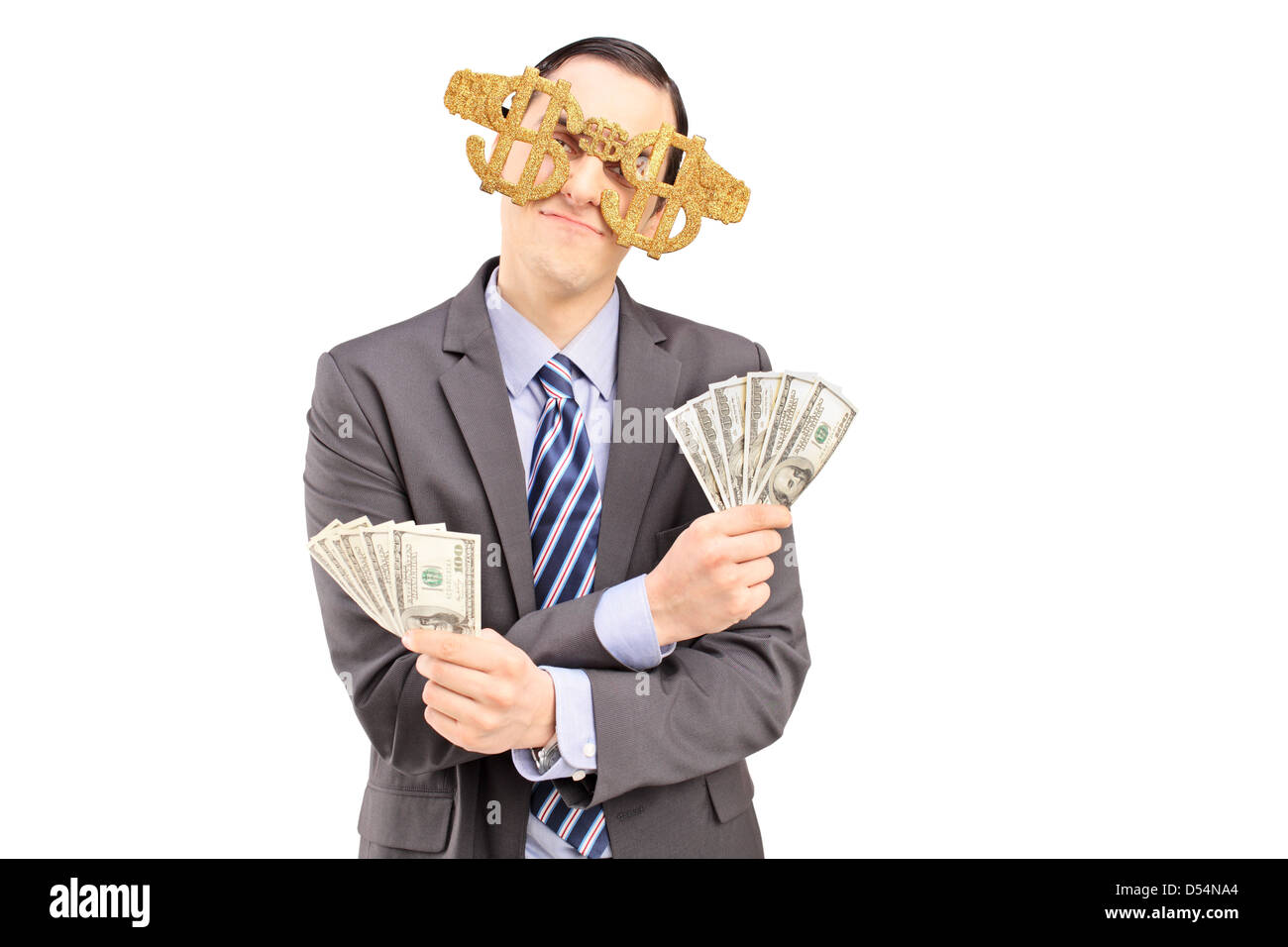 72c430eb2791 A young man wearing dollar sign glasses and holding US dollars isolated on  white background -