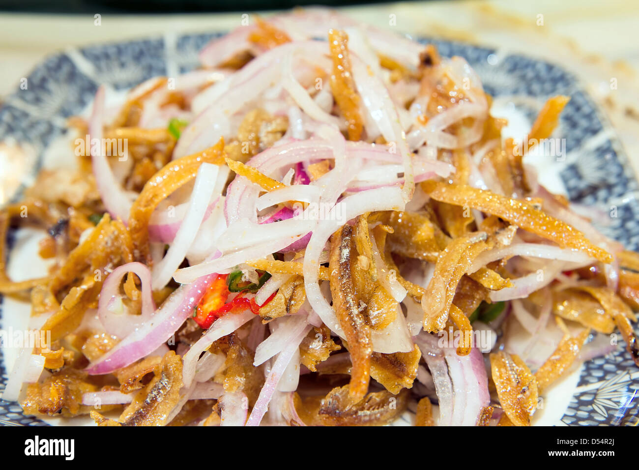 Nonya Peranakan Anchovies with Red Onions and Chili Dish Closeup - Stock Image