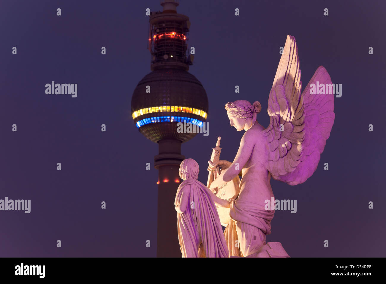 Berlin, Germany, figure Nike teaches the boy hero legends and the Berlin TV Tower - Stock Image