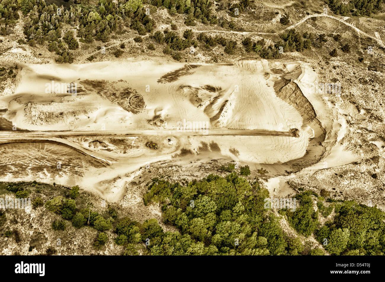 Aerial view of sand mining operation adjacent to Ludington Dunes State Park near Ludington, Michigan, USA. Photography - Stock Image
