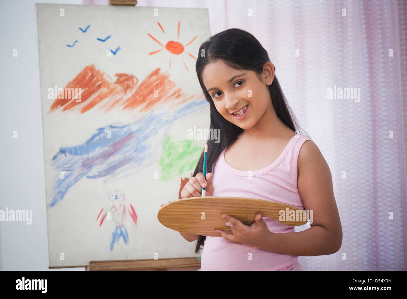 Portrait of a girl painting on artists canvas - Stock Image
