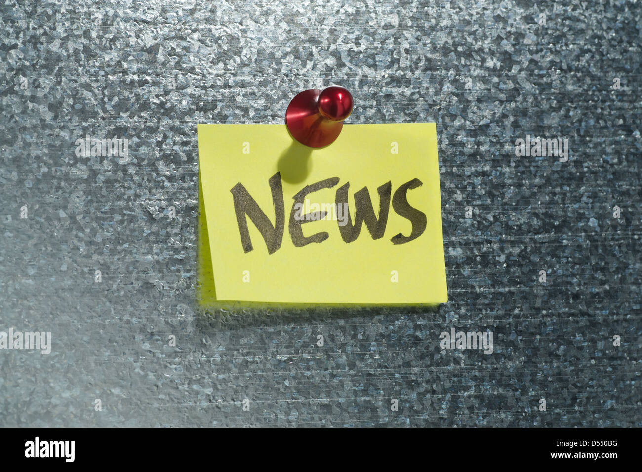 Hamburg, Germany, notes that says news depends on a magnetic wall - Stock Image