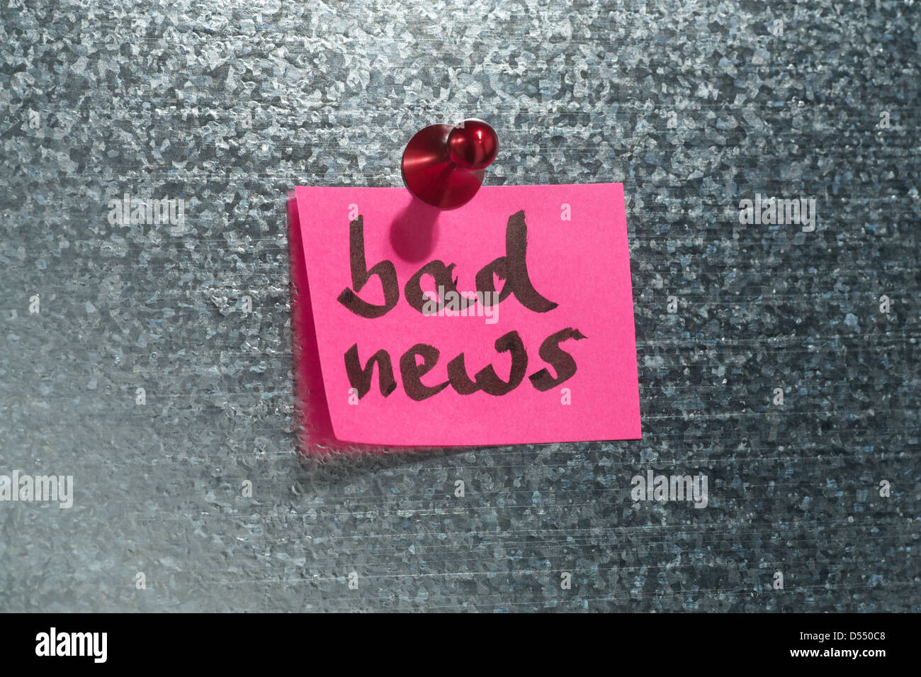 Hamburg, Germany, notes that says bad news depends on a magnetic wall - Stock Image