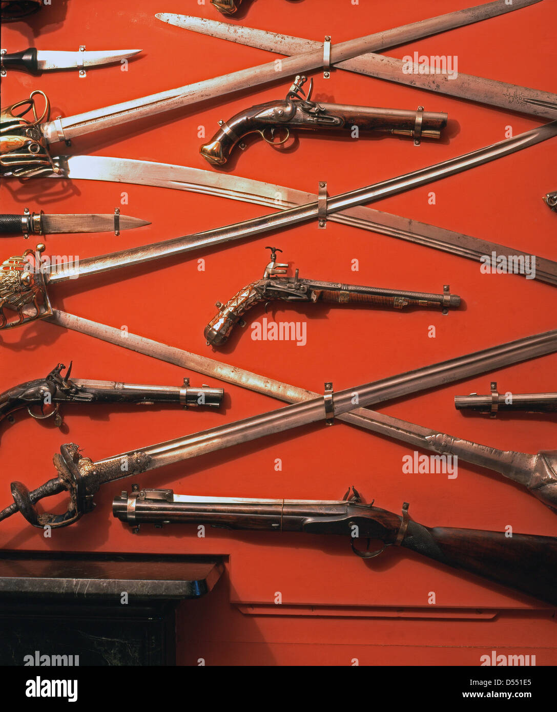 A display of antique swords and guns in Abbotsford House, formerly the residence of historical novelist and poet, - Stock Image