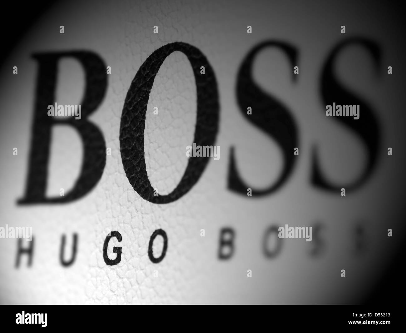 Hugo Boss logo with selective focus on the letters GO - Stock Image