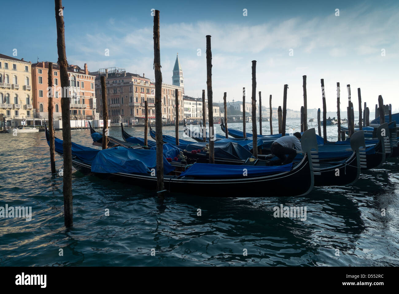 Gondolas moored at the entrance to the Grand Canal, Venice, Italy - Stock Image