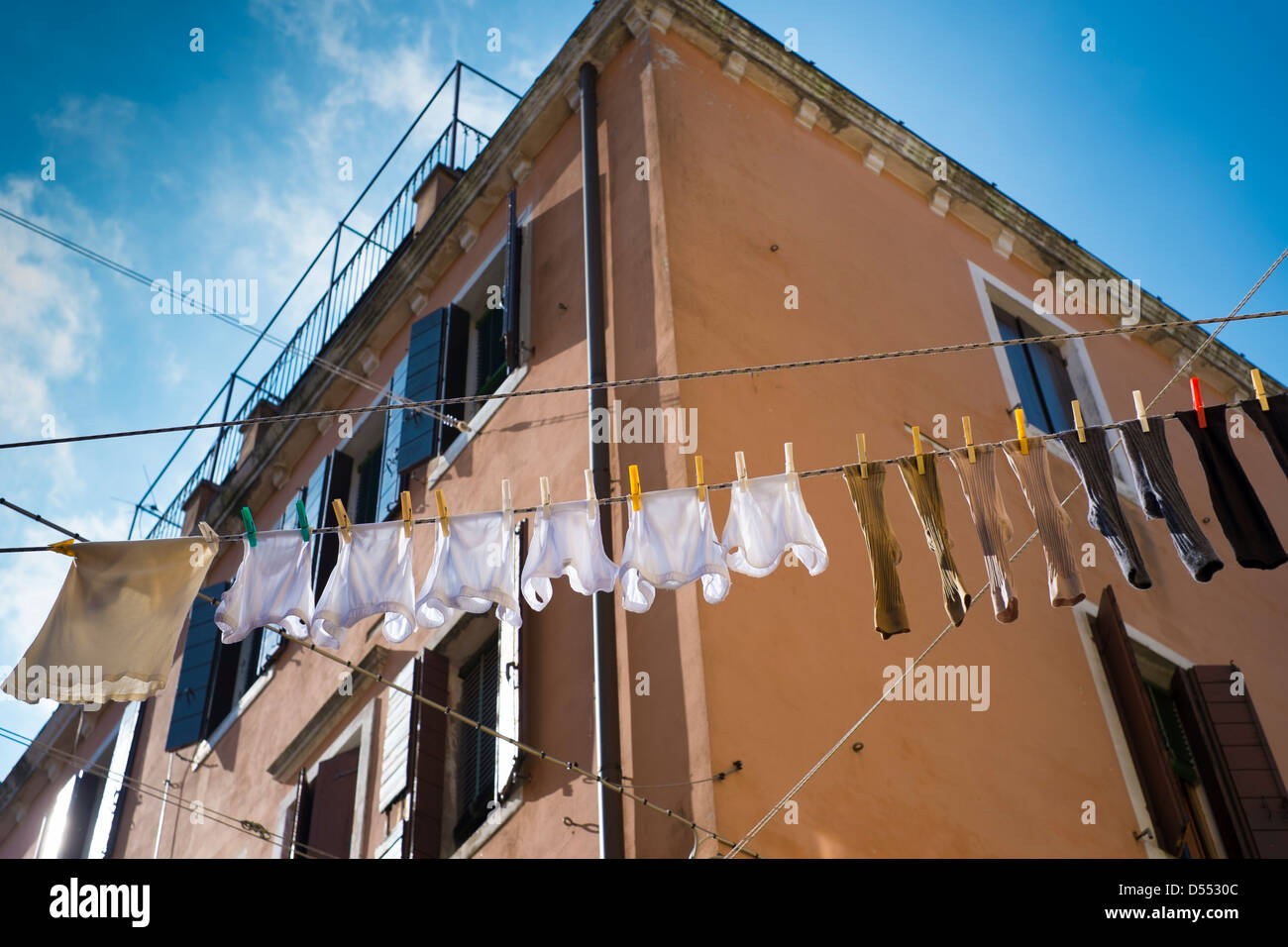 Hanging out the washing in Venice, Italy - Stock Image